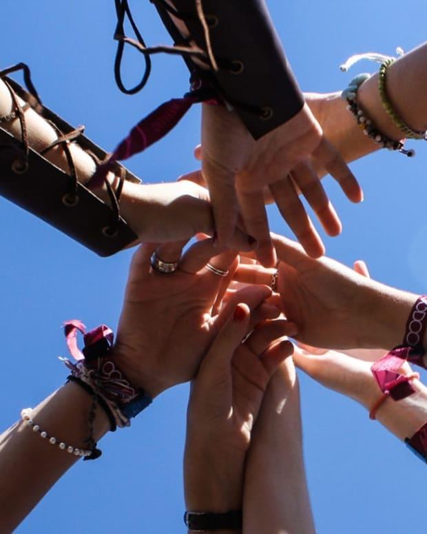 voodoo fest hands together