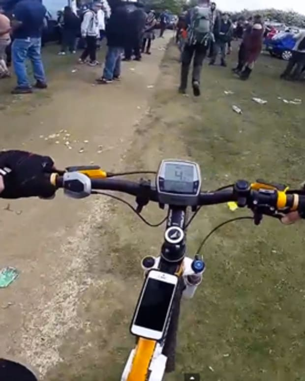 Watch A Countryside Bicyclist Stumble Upon An Illegal Rave