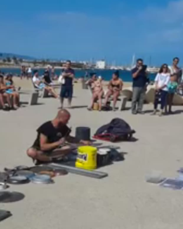 Legendary Street Performer Brings Techno To The Beach In Stunning Video