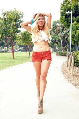 Camel Cutoff Shorts: Brandy Melville   Crochet Bikini Top: Forever 21   Crochet Crop Top: Forever 21   Headband: DIY   Feathered Earing: Sammi Ryan   Shoes: Lolita Jeffrey Campbell
