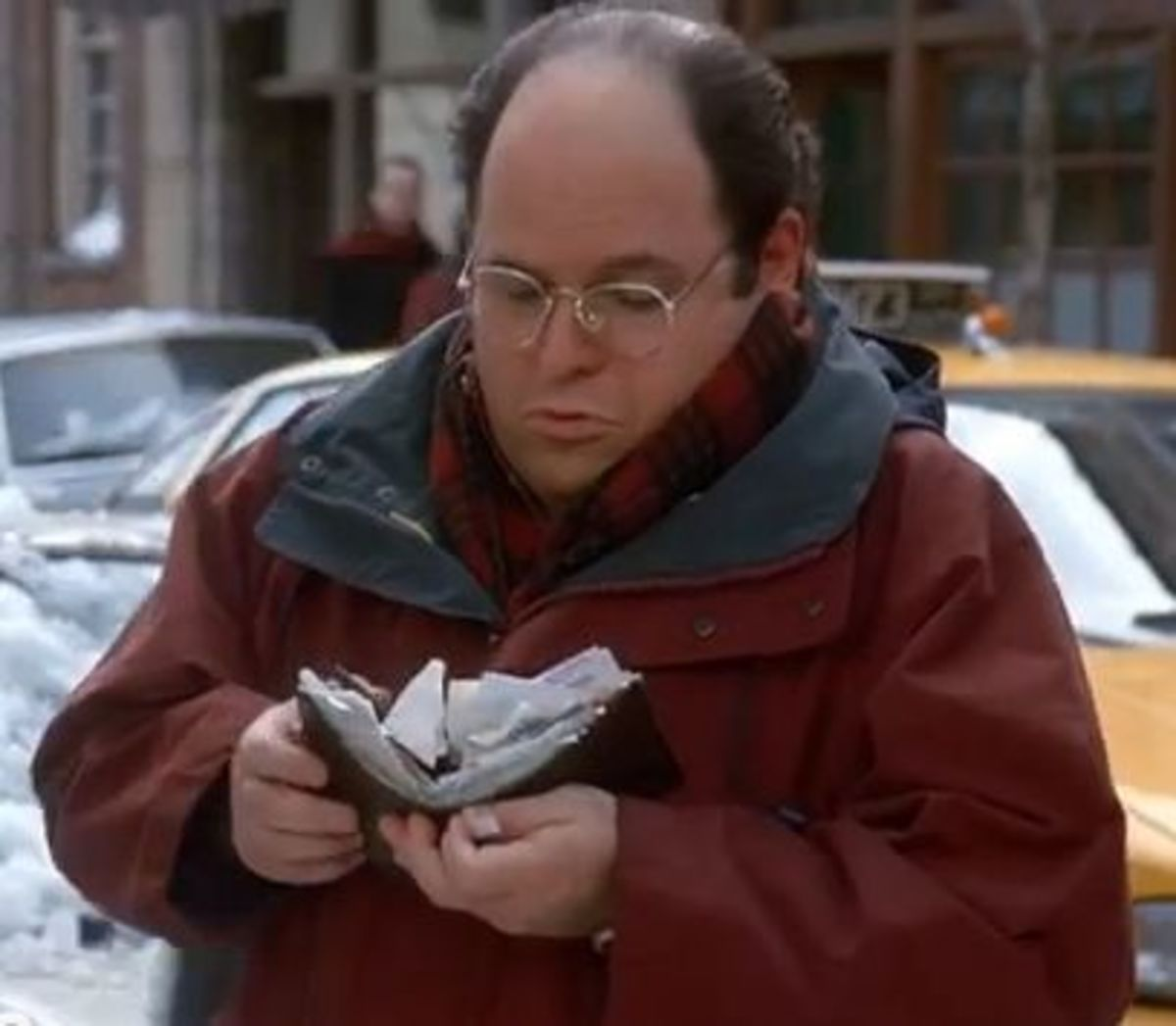 George and his huge stupid wallet.