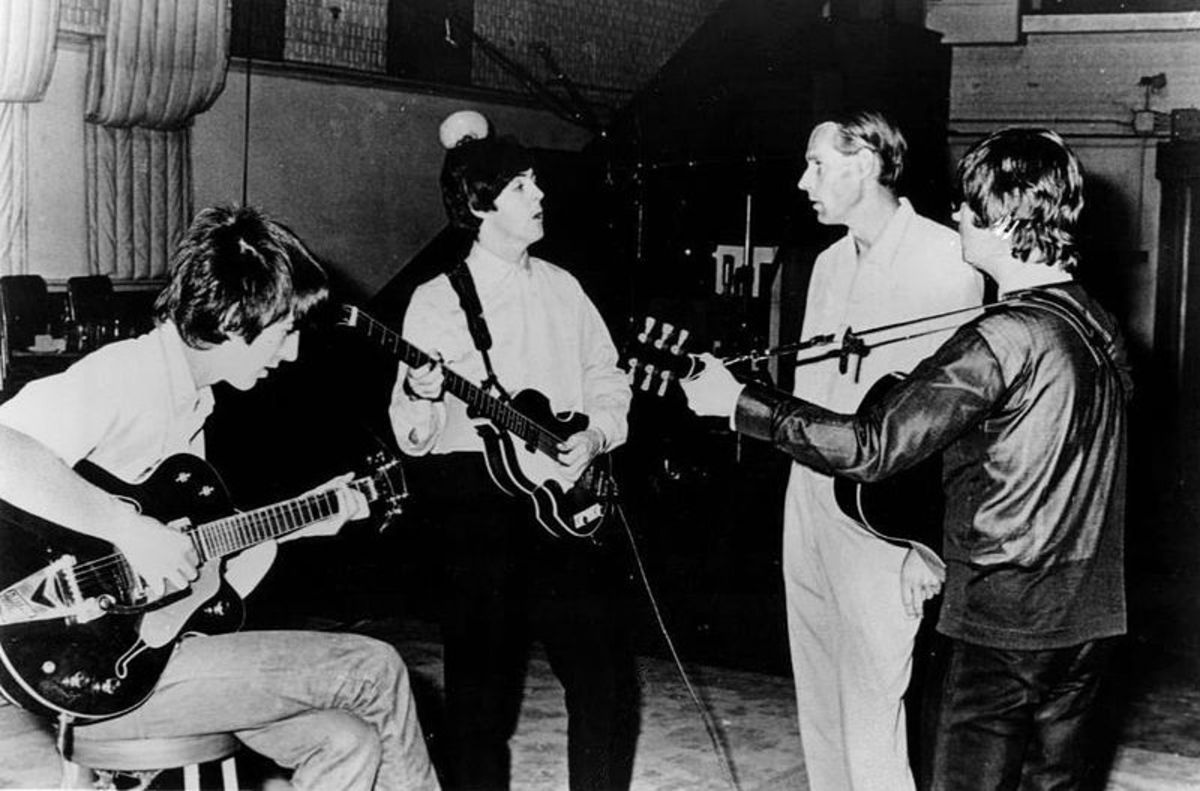George Martin with The Beatles during the mid 1960s (via Capitol Records)