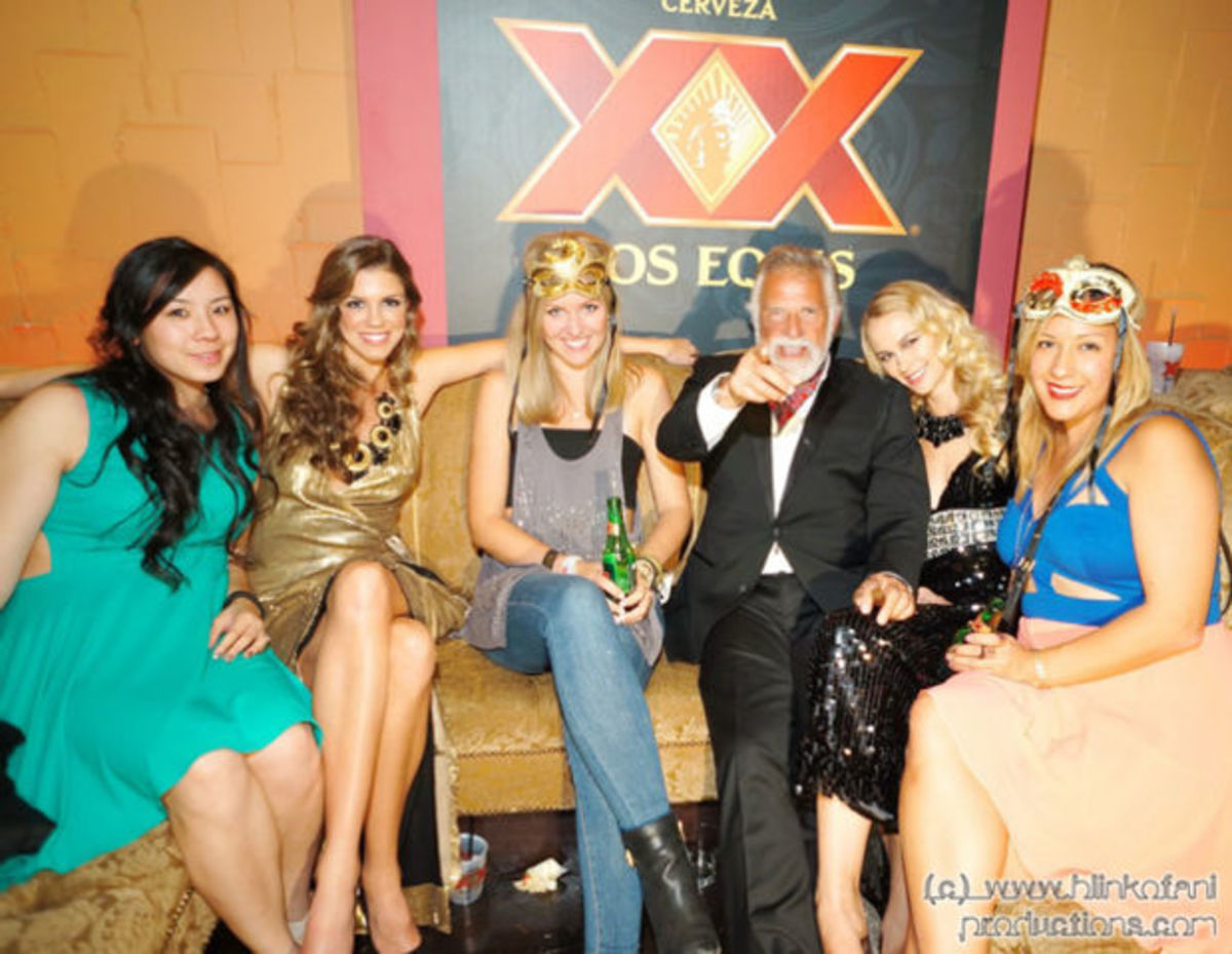 The Most Interesting Man surrounded by beauty at the Dos Equis Masquerade. (photo by Rich Kim)