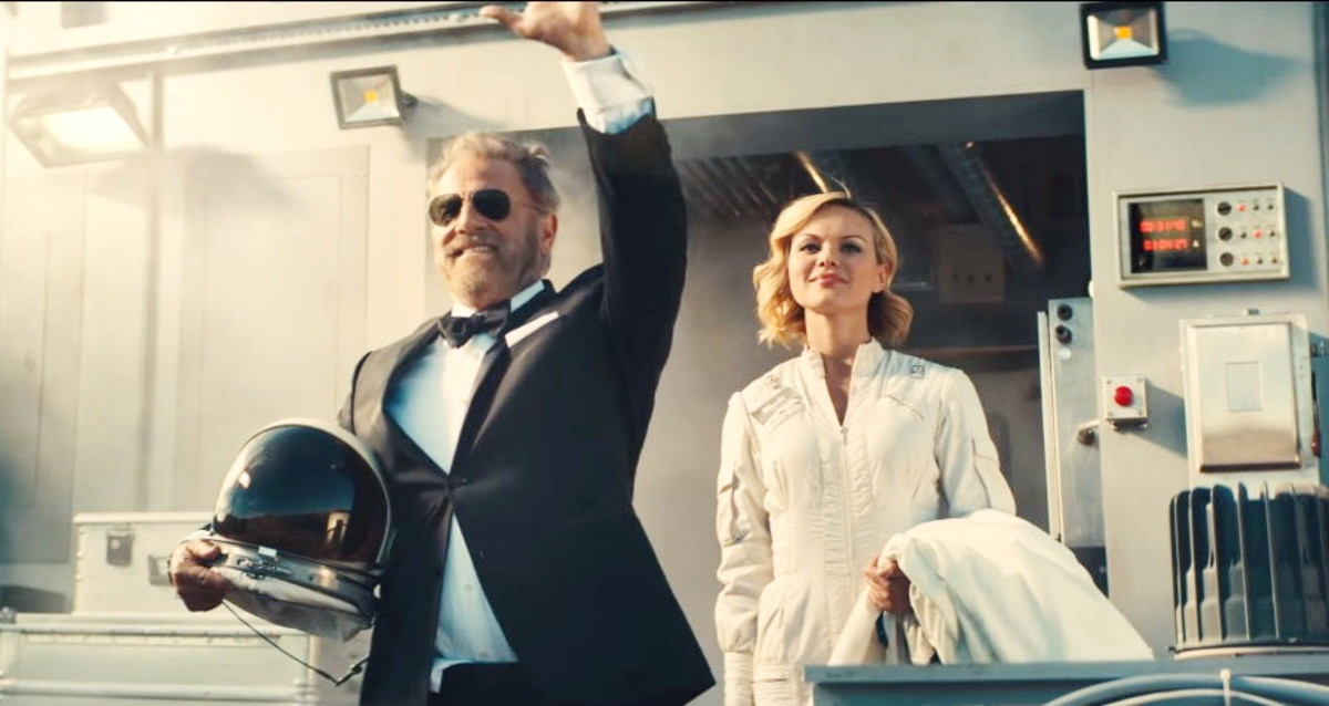 The Most Interesting Man waving farewell before taking off on a one-way ride to Mars.