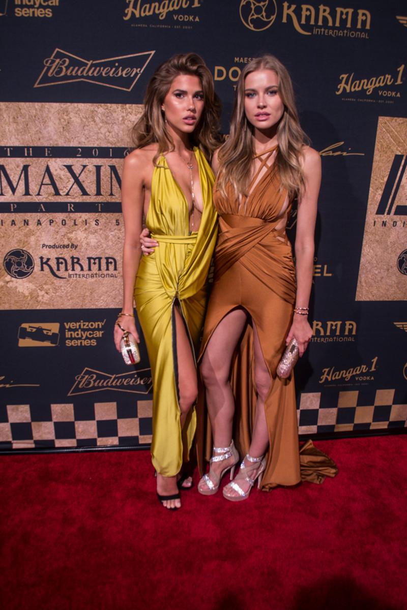 Models Kara Del Toro and Tanya Mityushina pose on the red carpet at the Maxim party.