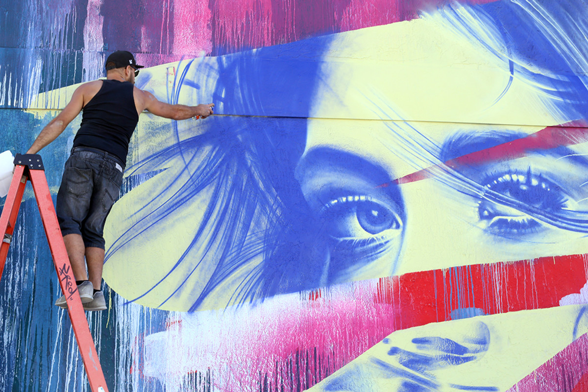 "Graffiti artist Fluke works on his piece ""Sola & Luna"" during Miami Art Week."