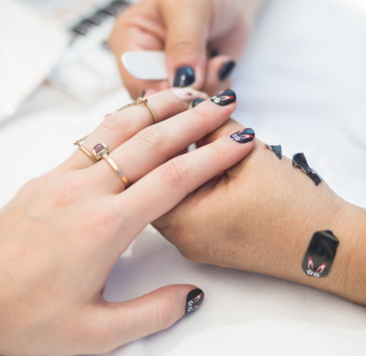 """getting her nails """"did"""" with custom MCM wraps by NCLA"""