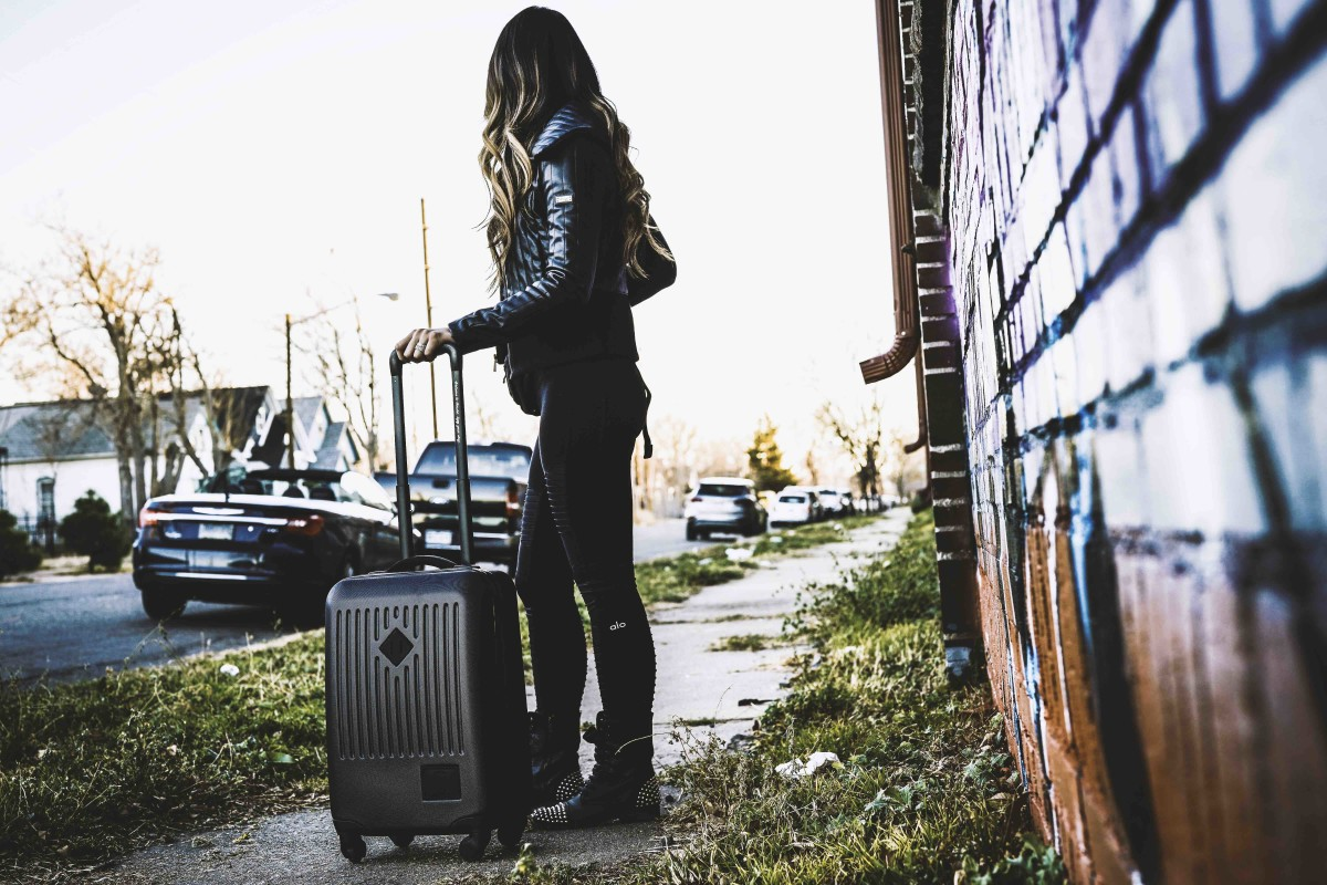 Armed with the carry on roller and hip pack, it's travel time | photo Jonas Tempel | Model - Kaori