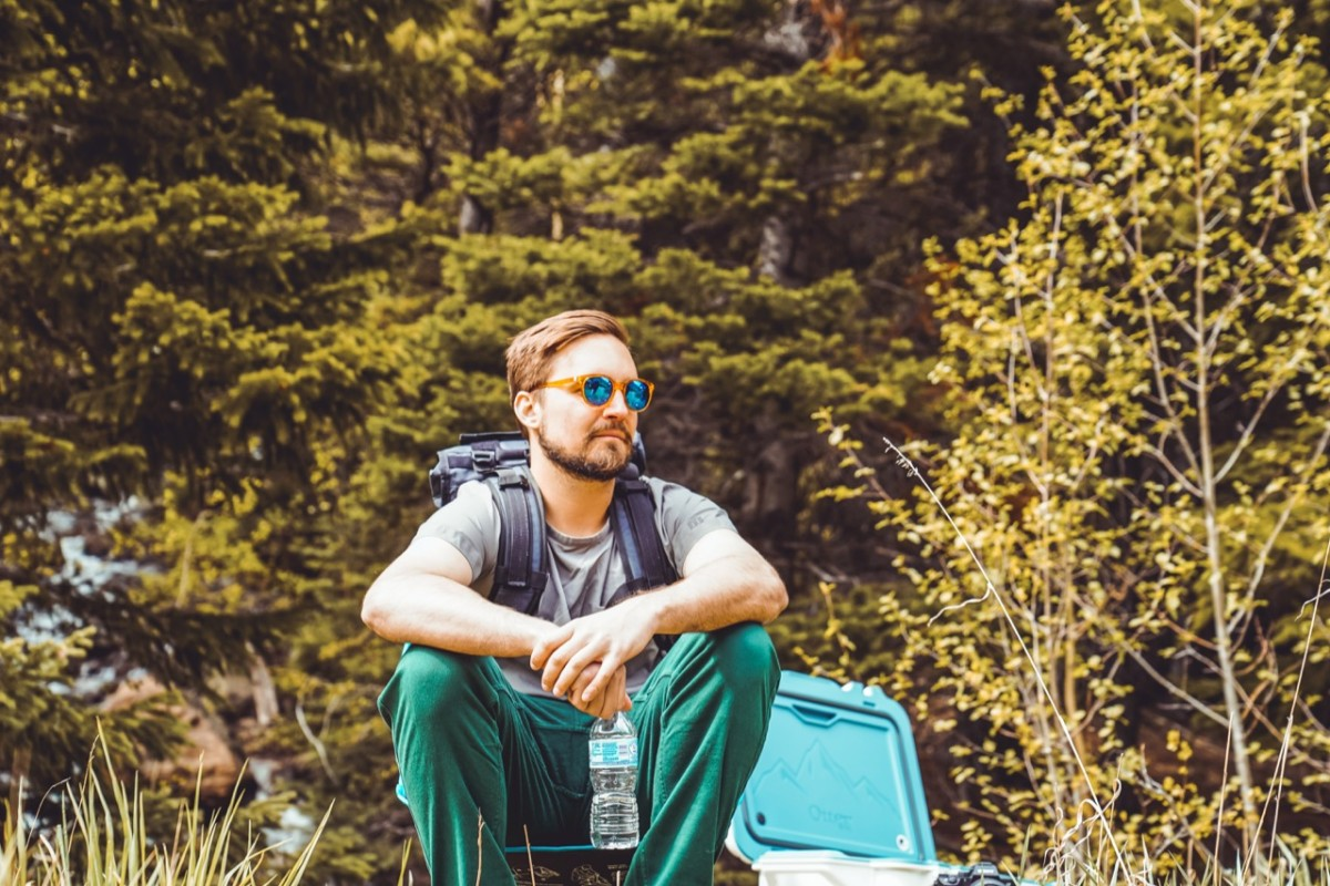 Alex wears Mission Workshop Rhake Backpack $365, Topo Designs Tech Popover $69 Shirt and Boulder Pants $89 and Susnki Makanis w/ Otterbox Venture 45 Cooler $299