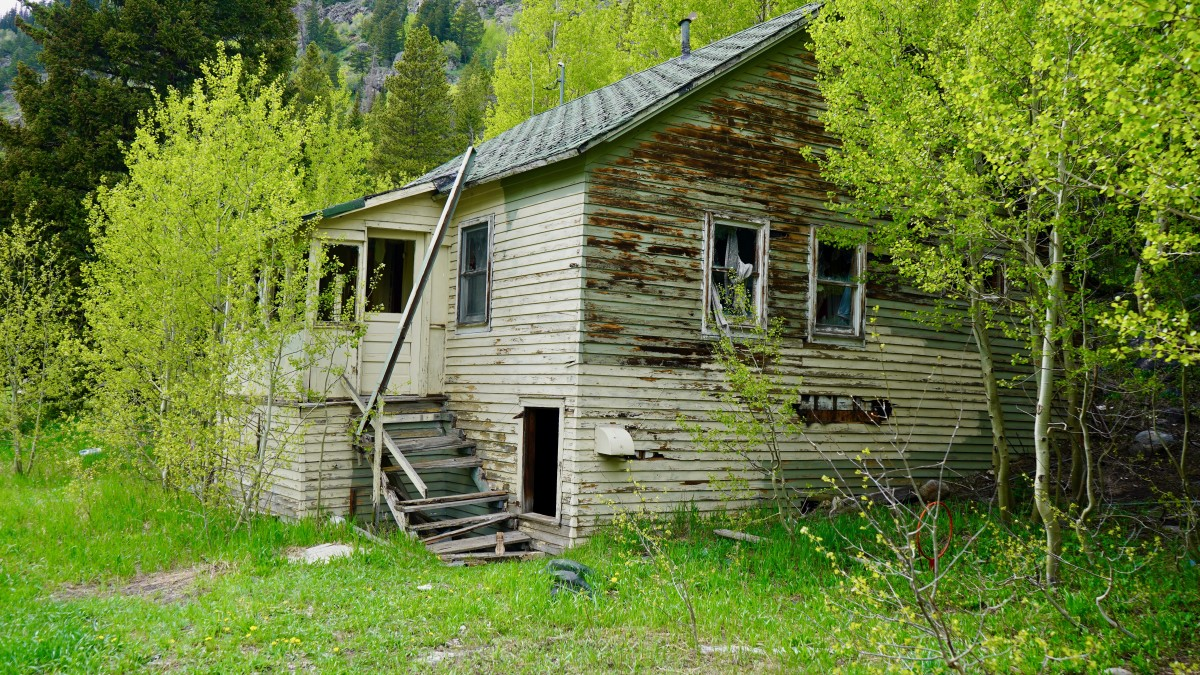 Creepy Cabin at Rollins Pass - look close, and you will see them... staring out the window at you.