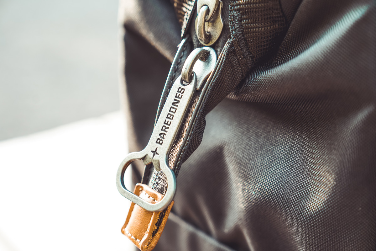 A bottle opener as a zipper. We love this little touch, because someone always forgets!