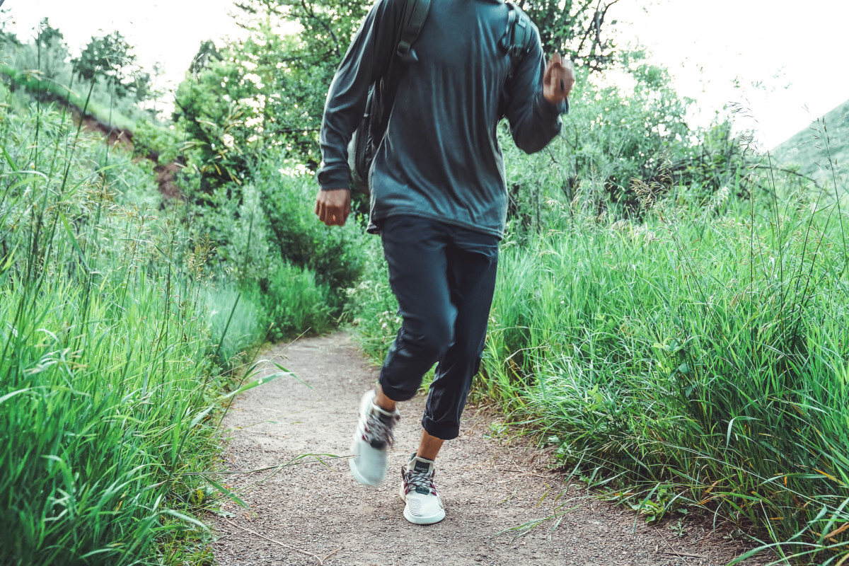 Cam wears Regular Stretch Chino Trousers by Goldwin and Merino Wool Hoodie from Chrome