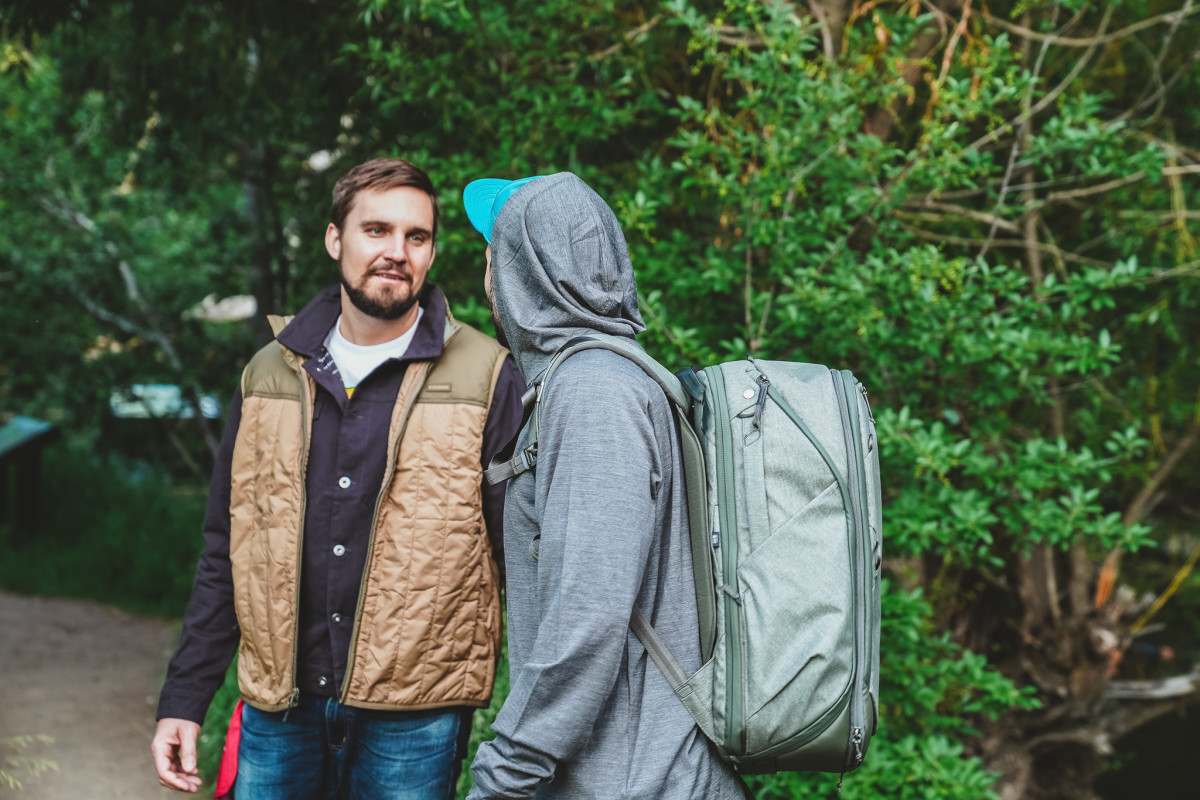 Alex wears Ultralight Vest from Filson, Jacket from Element x Bad Brains and Bandana from Insect Shield. Cam wears hat by Ciele, Merino Wool Hoodie from Chrome, and 45L Travel Bag from Peak Design.