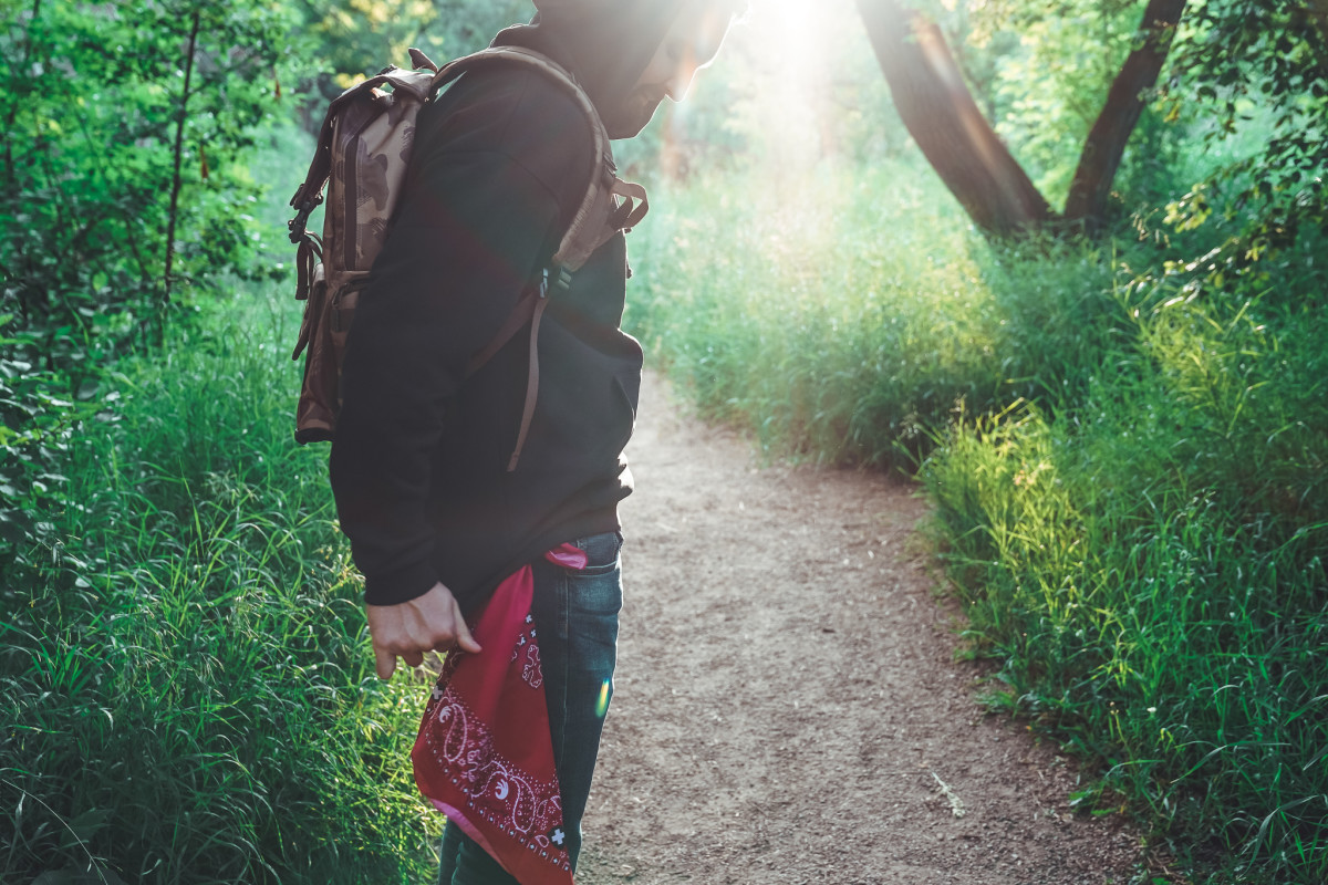 Alex wears Backpack from Element, Hoodie from Element x Bad Brains and Bandana from Insect Shield