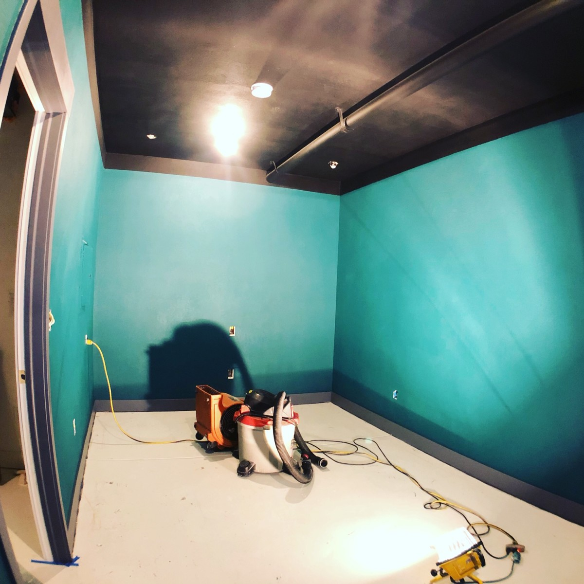 Magnetic Studio's gets a paint job, some trim and a bit of track lighting...