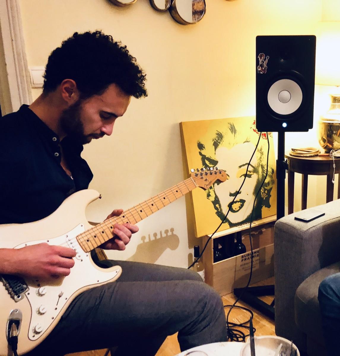 Hugo playing his Fender Strat
